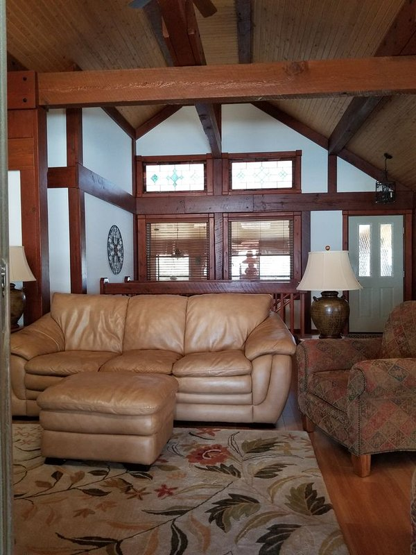 2 Story cathedral ceiling living room with beautiful natural wood beams