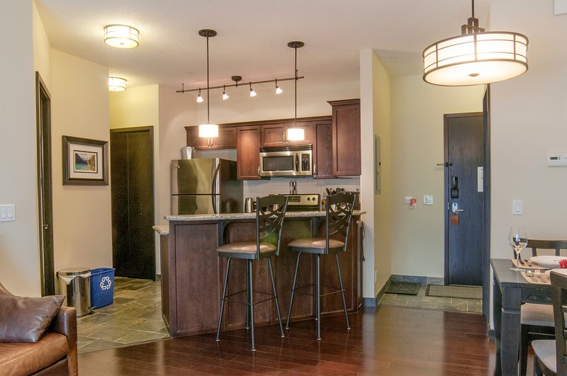Kitchen with bar stools for close interactions