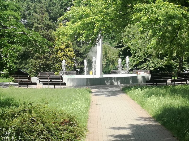 Romantic fountain in the park nearby
