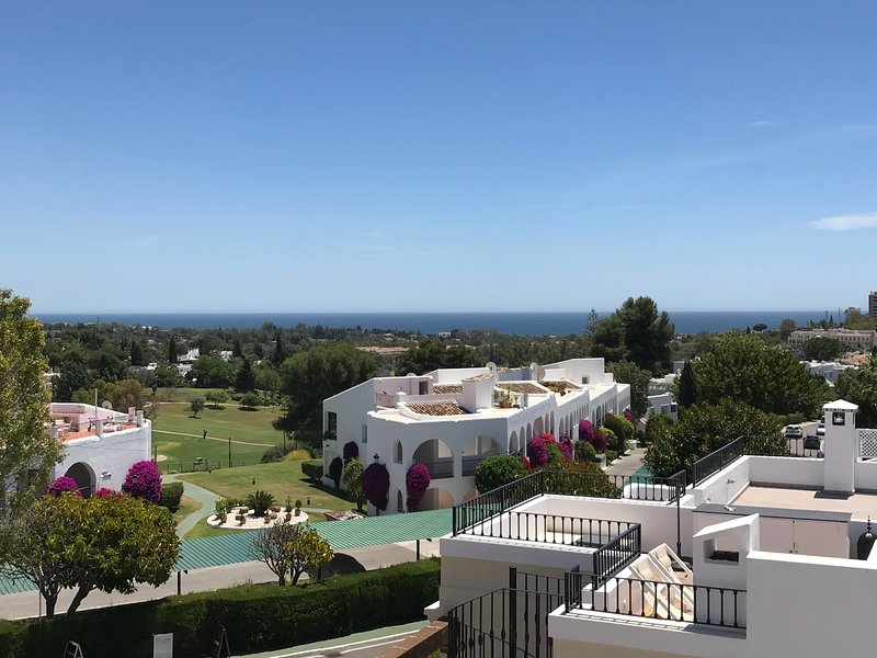 Sea and golf course view from sun terrace. On a clear day you can see Atlas mountains in Morocco