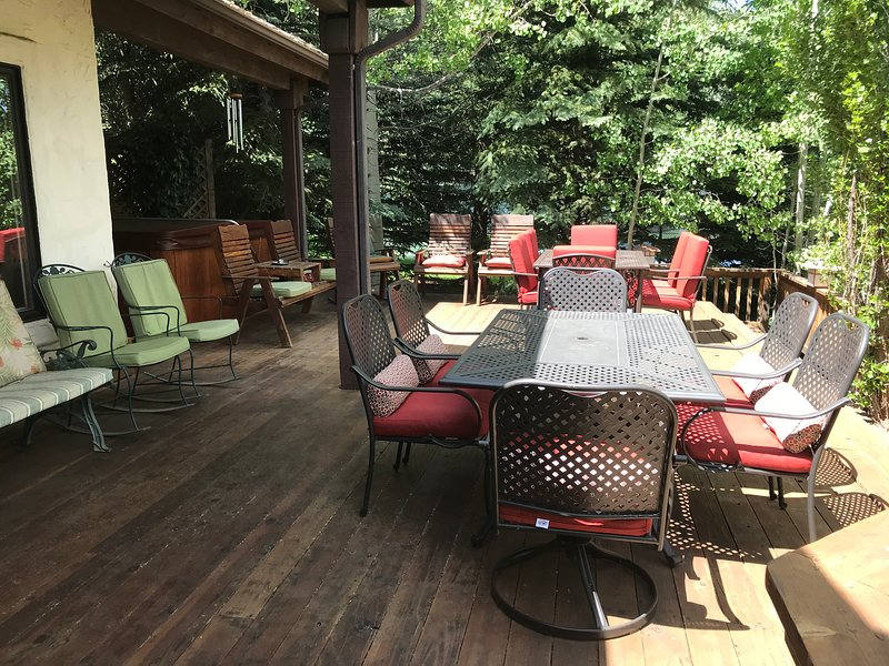 Deck seating is ample for outdoor dining and group interaction with those in the hot tub