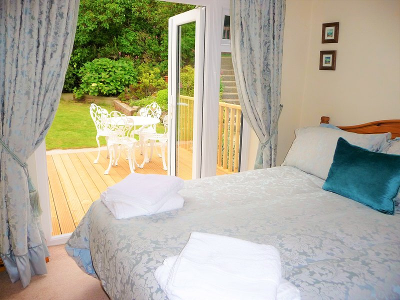 The comfortable garden bedroom with french doors to the patio