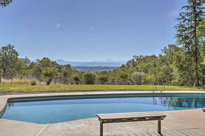 Soak in the sun and view from this Palo Cedro vacation rental house's pool!