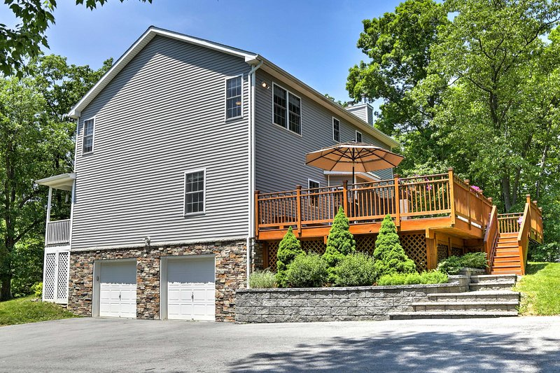 With 4 bedrooms and 2.5 baths, this home has plenty of space for 12 plus 2 more.