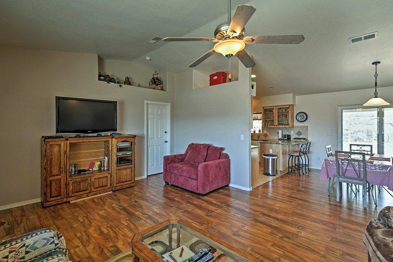 This open floor plan home has gorgeous hardwood flooring.