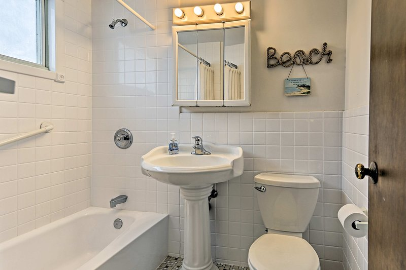 Rinse off after a day on the beach in the full bathroom.