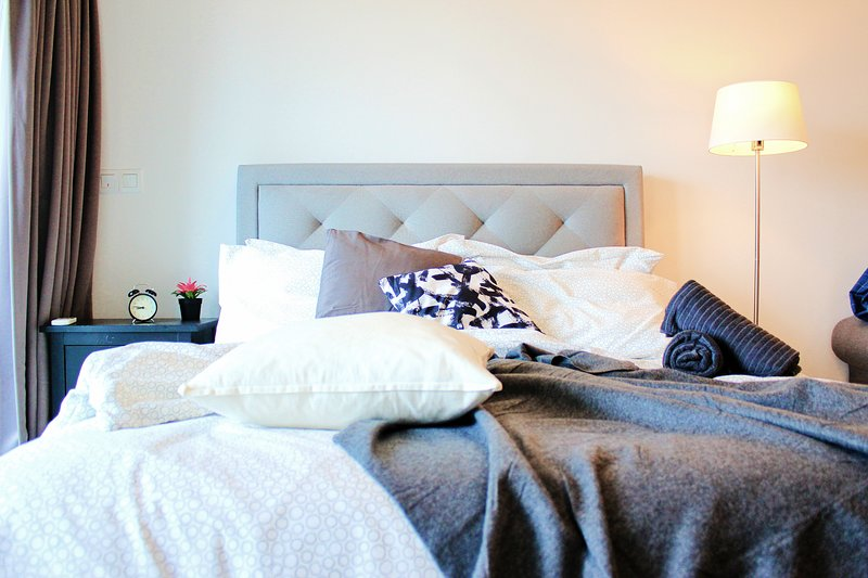 A queen sized bed with plush pillows.