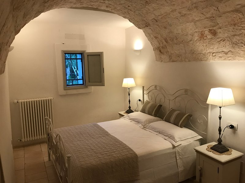The stunning Gyr luxury bedroom with ensuite, within the barrel vaulted ceiling from a bygone time.