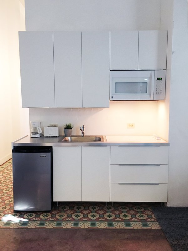 Private kitchen has: dishes, fridge, microwave, coffee maker, toaster and more.