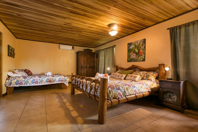 King-size bed, custom-made with Laurelwood. Spacious and comfortable with bed-side reading tables.
