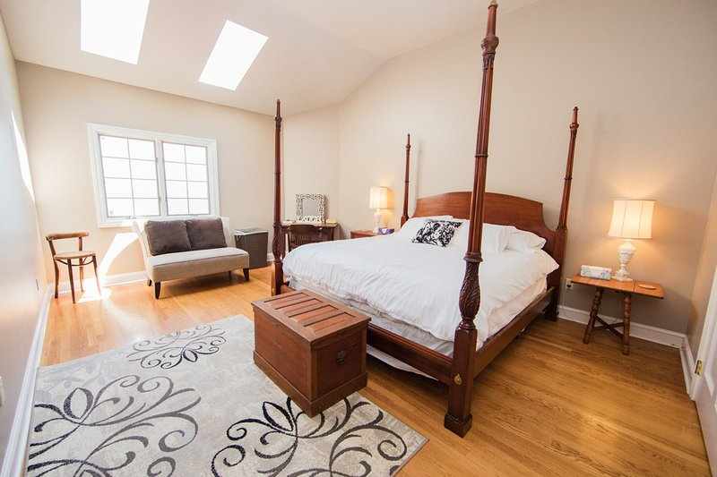The 4th bdrm is at the top of the second staircase has a plush king bed, + sitting area