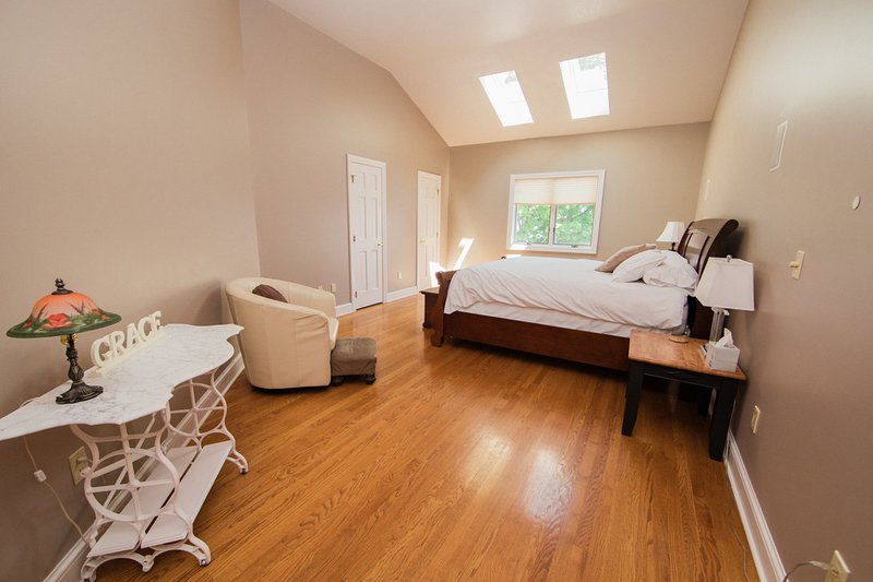 The 5th bdrm is at the top of the second staircase has a plush king bed, + sitting area