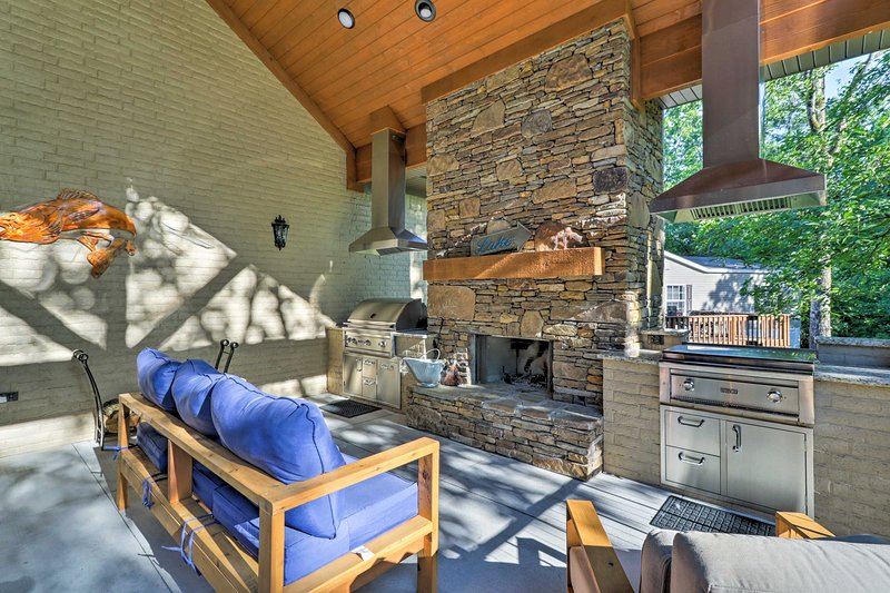 This home includes an outdoor kitchen and 2 private boat slips.