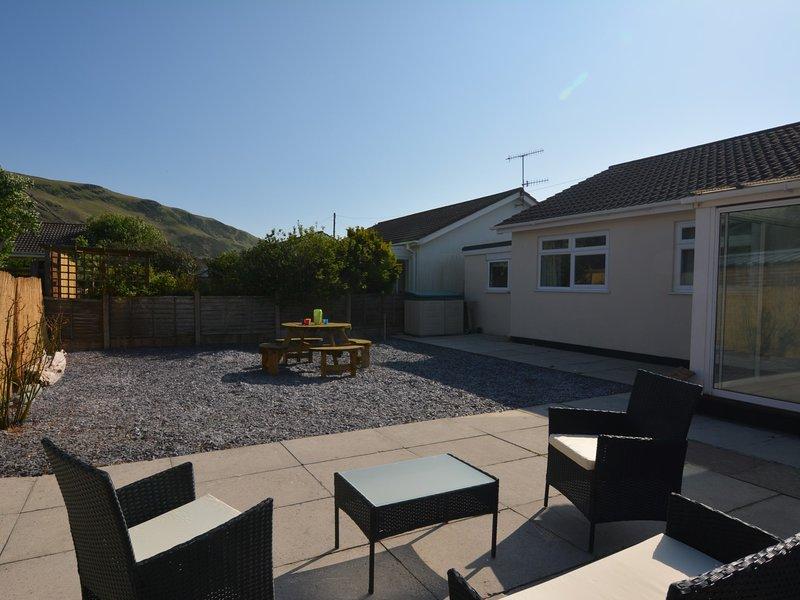 Uitzicht op de woning met een mooie privétuin / patio
