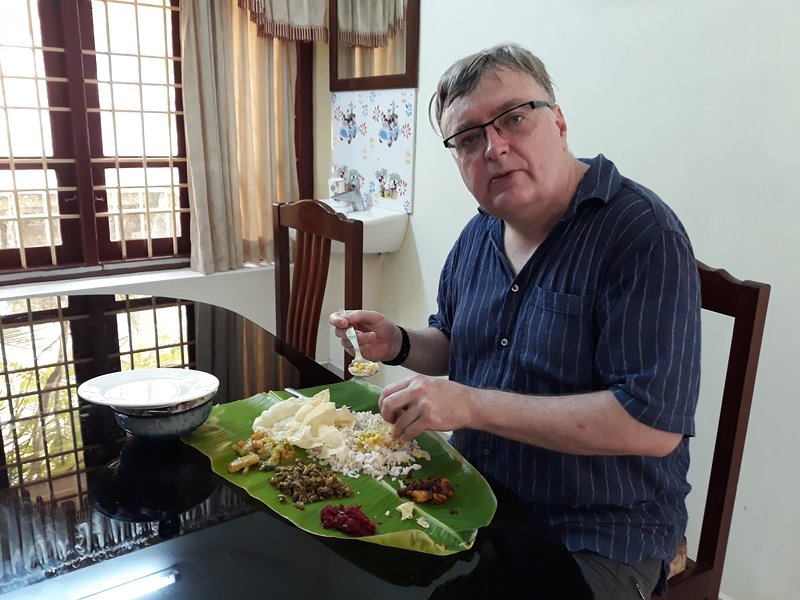 Our Valuable Guest Having Traditional Food in Banana Leaf