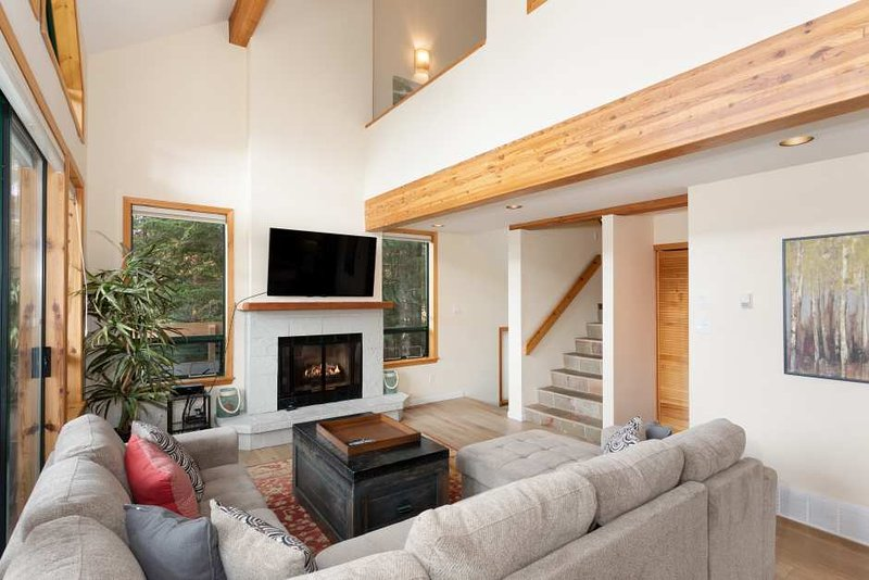 Bright Open Living Area with Gas Fireplace