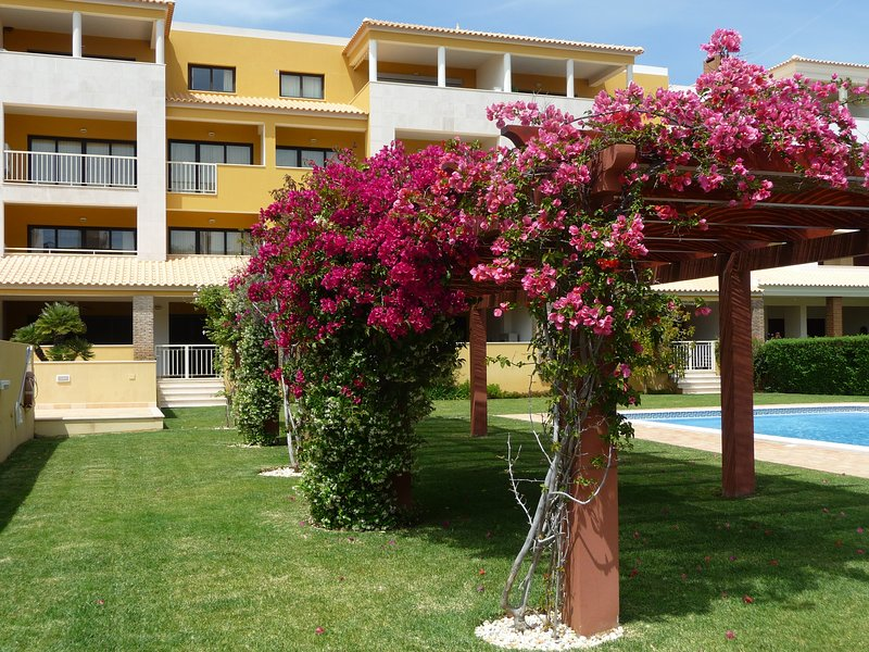 Bougainvillea and fragrant jasmine line the 2 pools