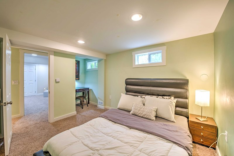 Two travelers can rest in this third queen bedroom.