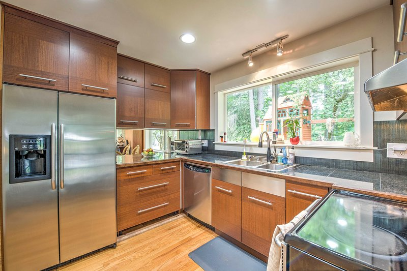 Stainless steel appliances add a polished look to the full kitchen.
