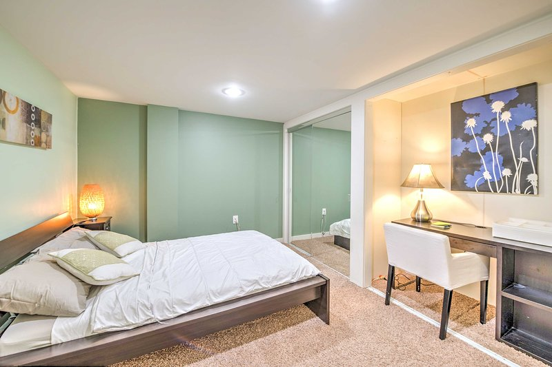 Seafoam green walls give this bedroom a soothing ambiance.