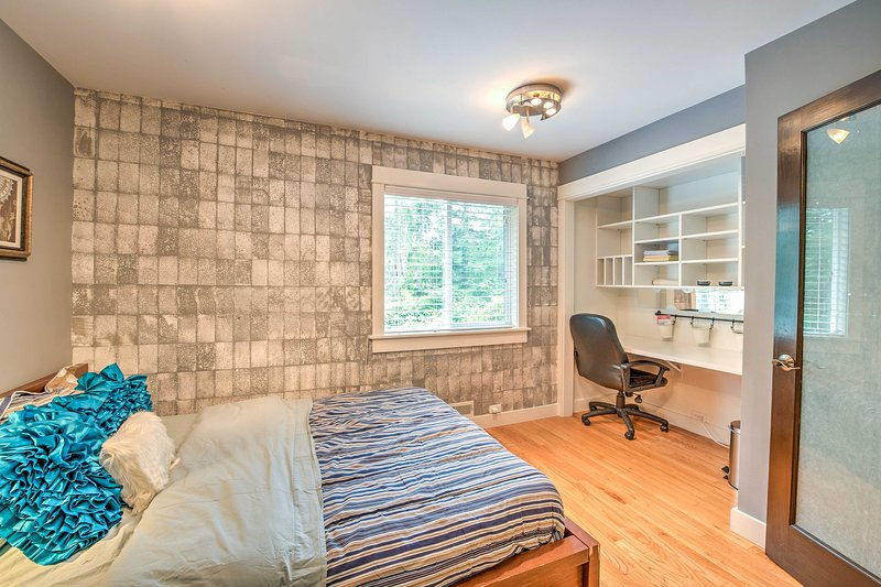 Built-in shelving and desk space is featured in the corner.