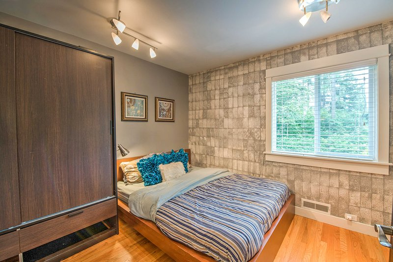 This second bedroom provides a queen-sized bed.