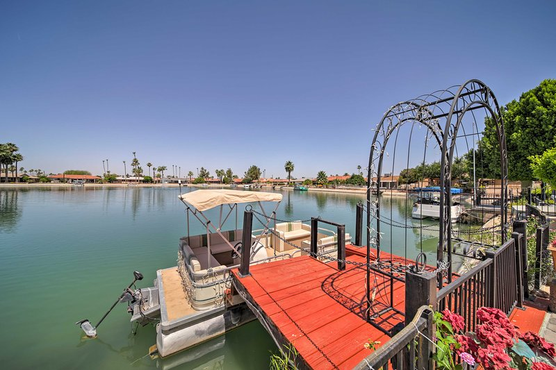 This home includes a private pool, boat, and pool table!