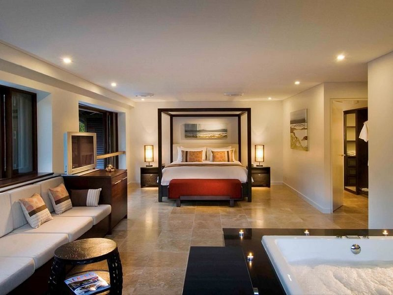 Master Bedroom Suite with walk-in-wardrobe, private lounge and jacuzzi spa