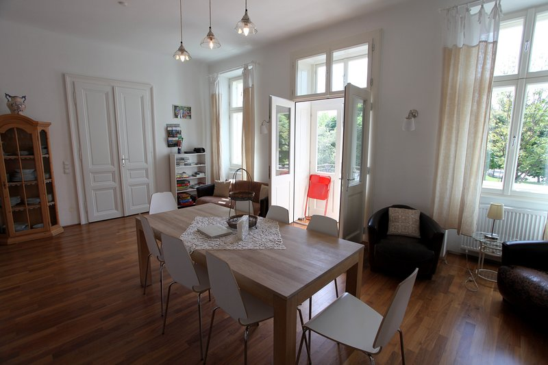 Kitchen and dining area, view to Augarten-Park