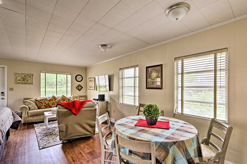 The light-filled interior boasts a queen bed, bathroom, and full kitchen.