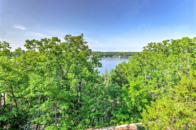 Up to 12 guests can enjoy views of the Lake of the Ozarks from 3 private decks.