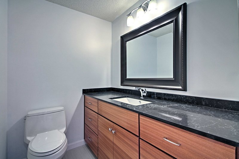 This half bath is on the main level located off of the kitchen.
