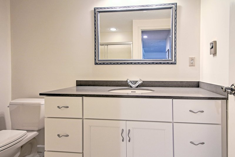 This full bathroom is located on the lower level is shared by the two bedrooms!