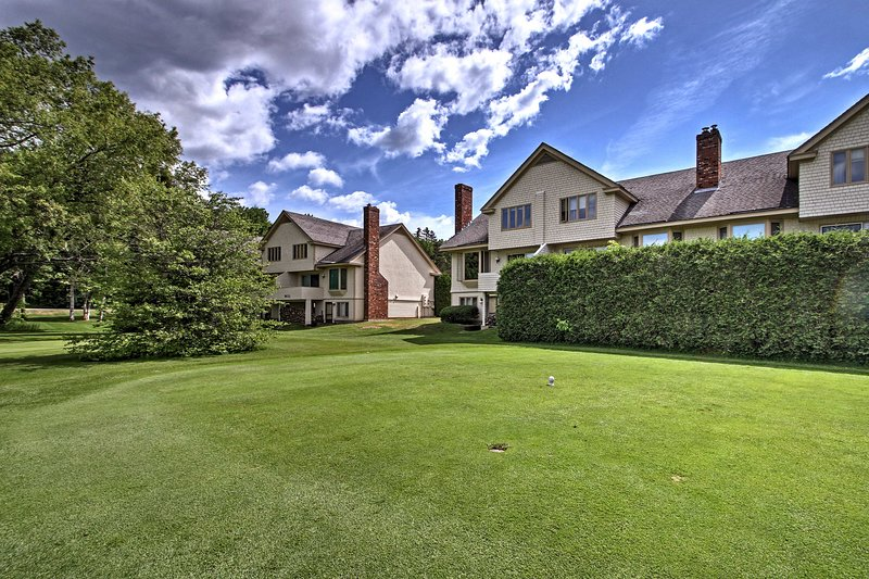 Lush landscaping surrounds this property.