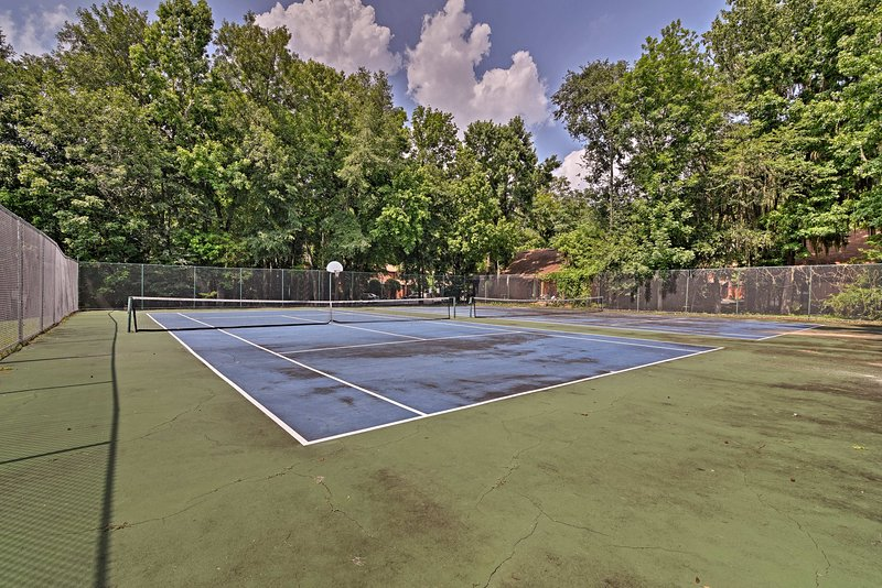 A fun family activity awaits on the tennis courts.