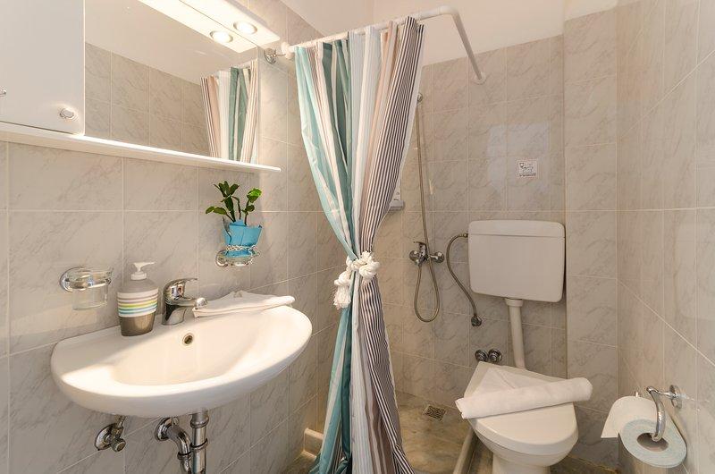 bathroom in between the room spaces