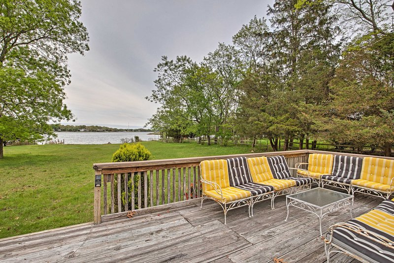 Enjoy deck seating and water views from this Sag Harbor vacation rental house.