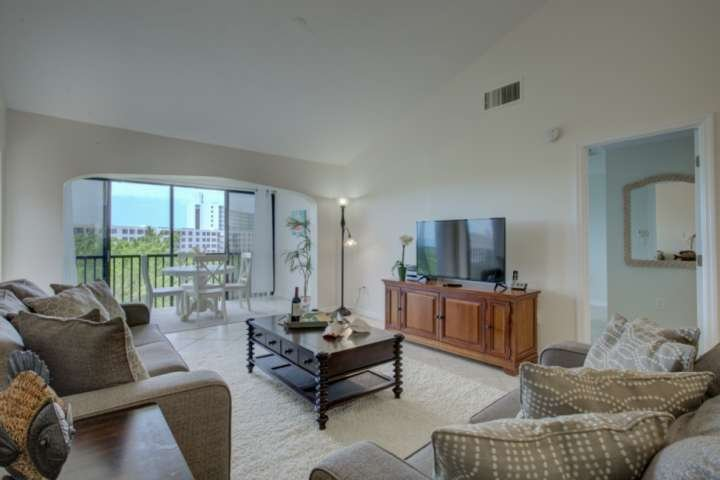 Beautiful living room with tile floors, 55' flatscreen and amazing views from your private enclosed balcony.