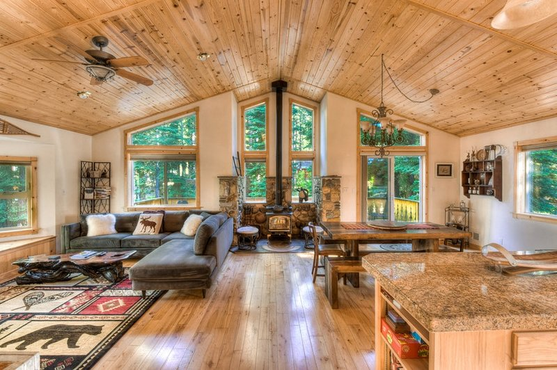 Beautiful open living / dining rooms and kitchen upstairs with wood burning fireplace