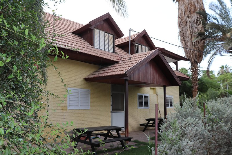 Huge house with 2 floors, two big terrasses, sitting areas outside and a BBQ.