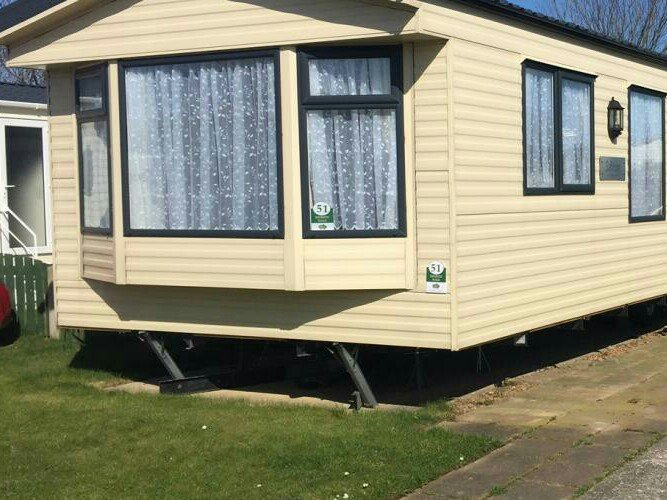 Caravan double glazed and central heating with private garden and car park