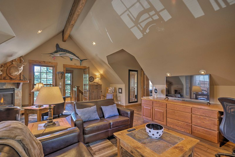 The interior is lined with hardwood floors and vaulted ceilings.