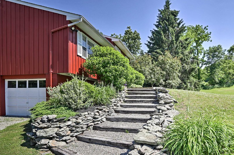 Head down the stairs and explore the large property.