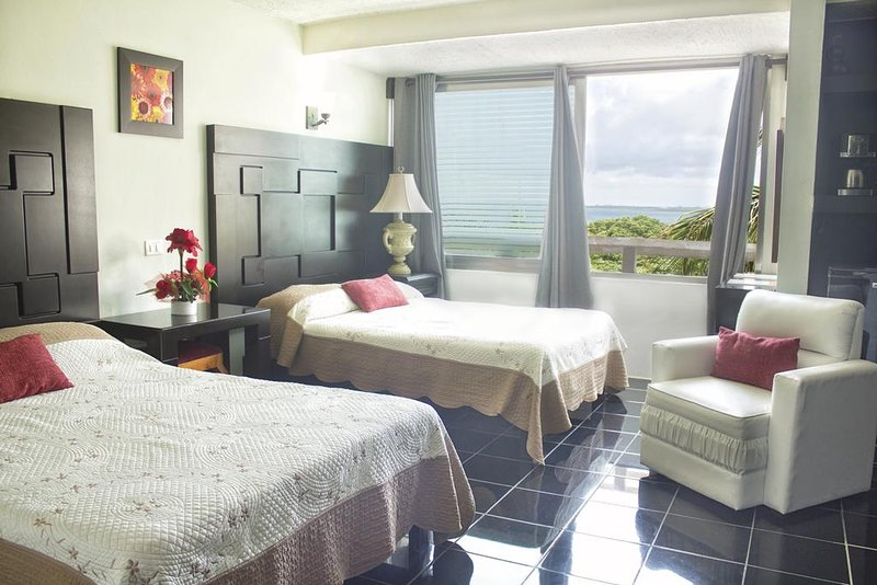 Bedroom with Lagoon View at Rodero by Solymar Beach Front Condos
