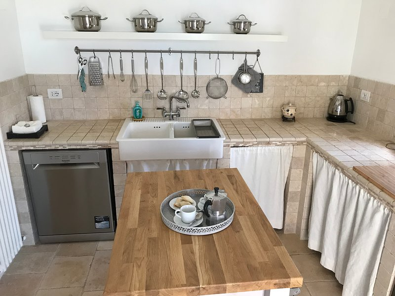 Kitchen with dishwasher and twin ceramic sink great storage and ample kitchen utensils.