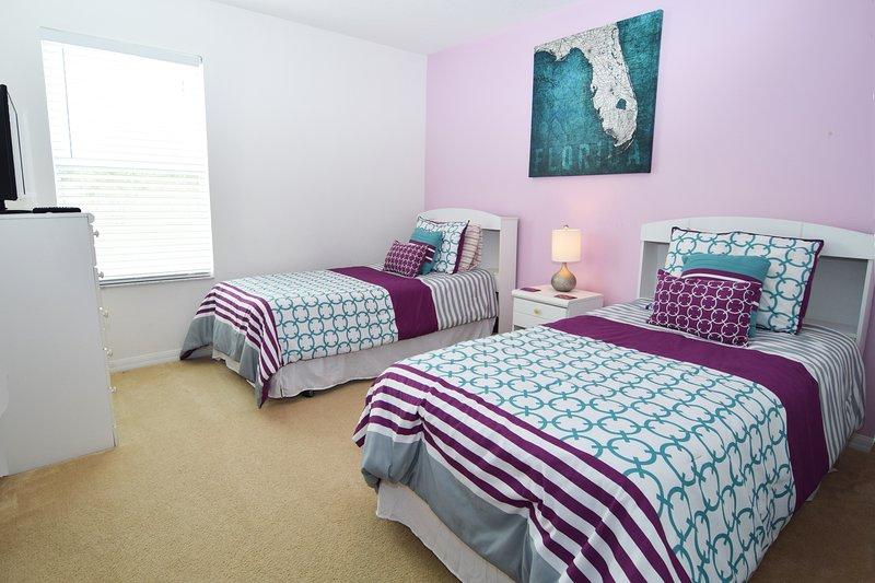 Bedroom 3 is a twin room with en suite