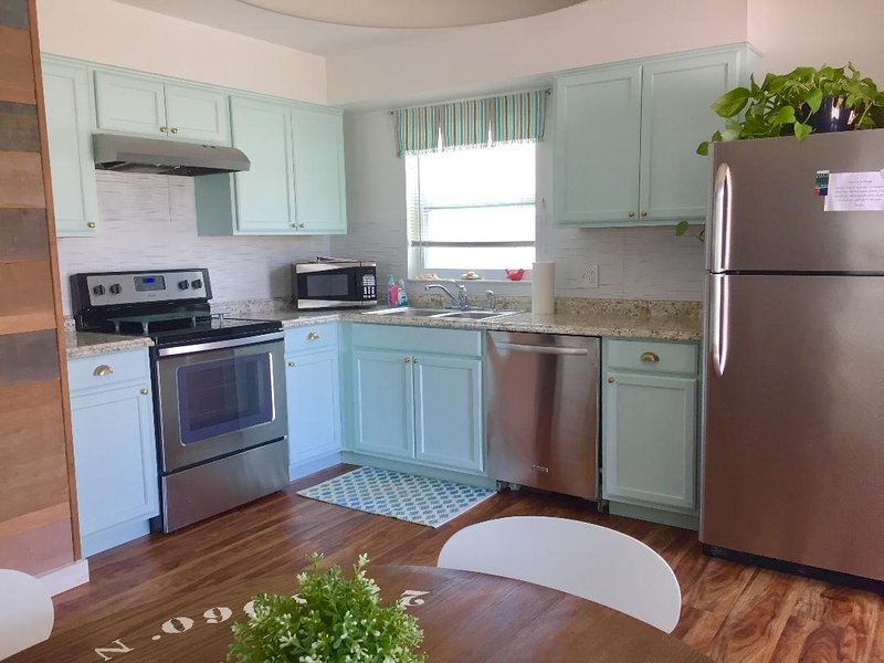 Full kitchen with all appliances/ pans/dishware plus washer & dryer in unit