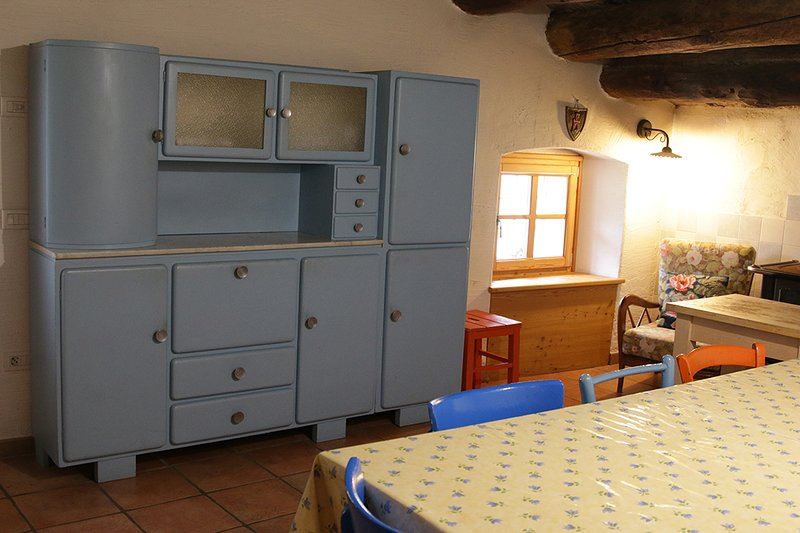 The spacious kitchen with stove