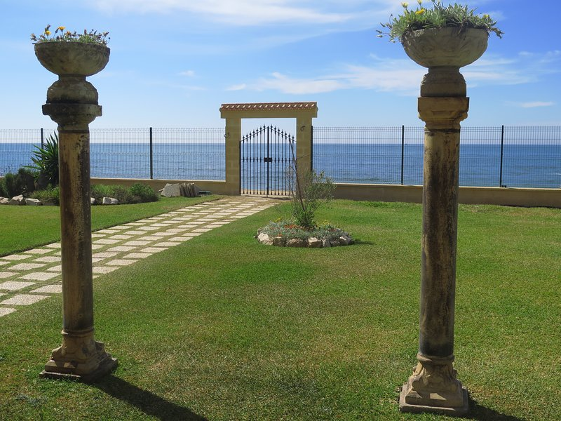 extensive gardens and manicured. The bottom one of the interior doors to the beach.