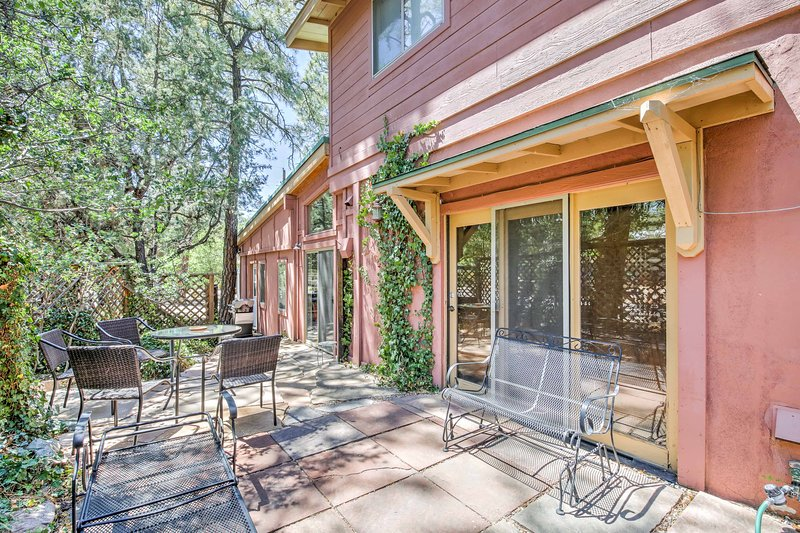 Mature pine trees surround this peaceful property.
